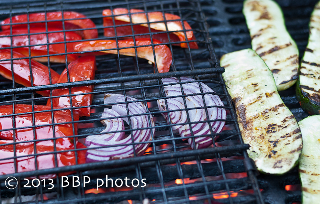 Grilling peppers, onions and zucchini to get a nice char on them.