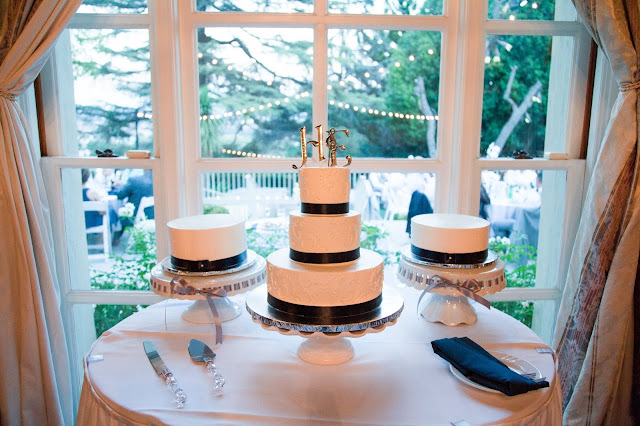 Our Kellogg House Wedding and Reception was absolutely beautiful. The backyard was perfect with white linens and bistro lights over the yard. We had three beautiful white cakes with a navy blue ribbon.