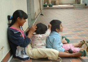 Children playing with each others hair.