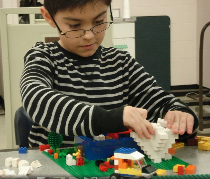 Kid building LEGO tornado at Davis