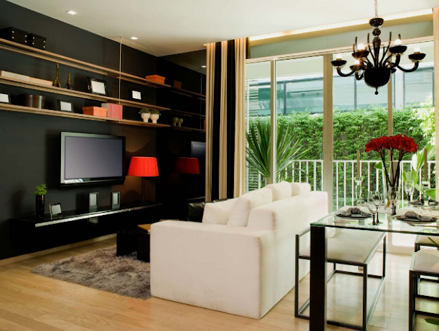 A giant black box dominating the space is never a good look for living room