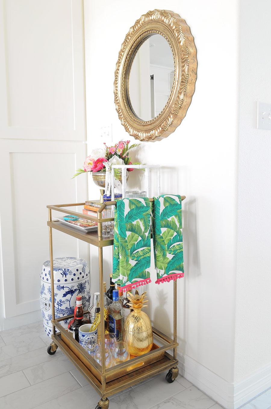 A gold bar cart looks stylish and chic for spring with touches of pink, gold, florals and chinoiserie vibes.