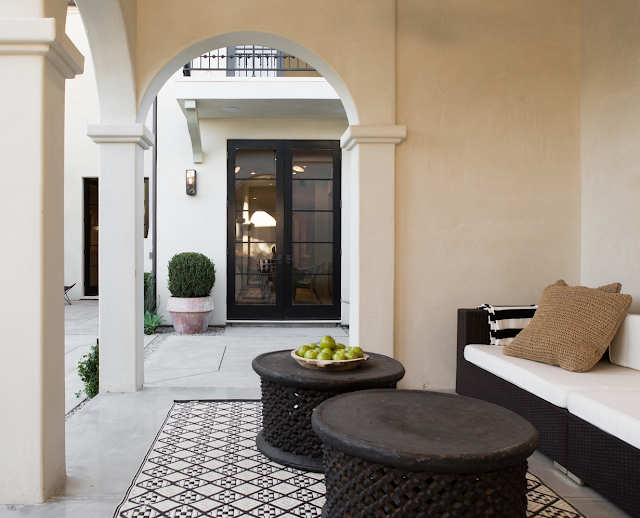 Beautiful patio in villa with European inspired interiors by Leigh Herzig - seen on Hello Lovely