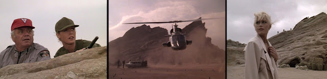 ERNEST BORGNINE and JEAN BRUCE SCOTT as 'Dom' and 'Caitlin' look on as Airwolf blows up Horn's base and neutralises his forces. CATHERINE HICKLAND playing 'Angelica Horn' looks back after ensnaring 'Hawke'.