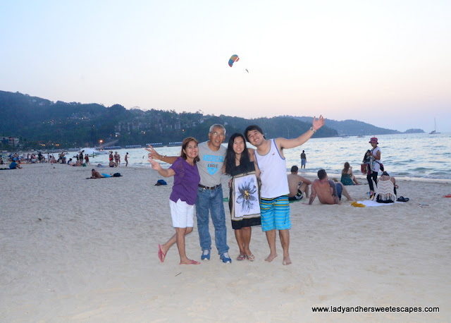 family in Patong Beach before sunset