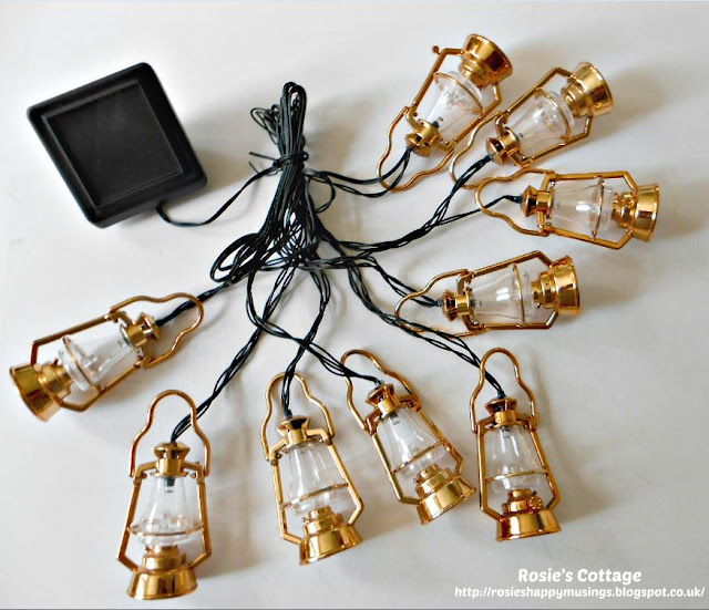 Pretty solar string lights designed to look like oil lamps...