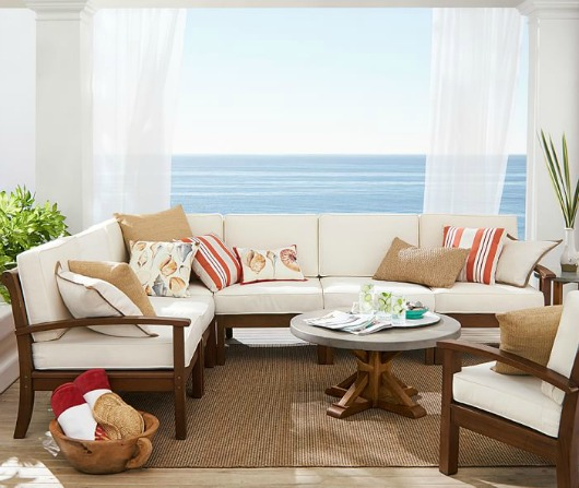 Outdoor Sectional from Pottery Barn with Orange Pillows