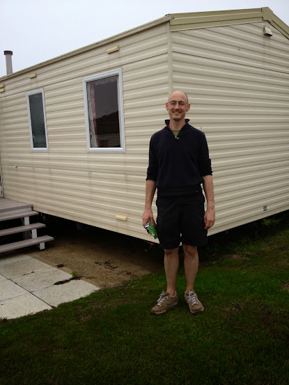 man outside caravan