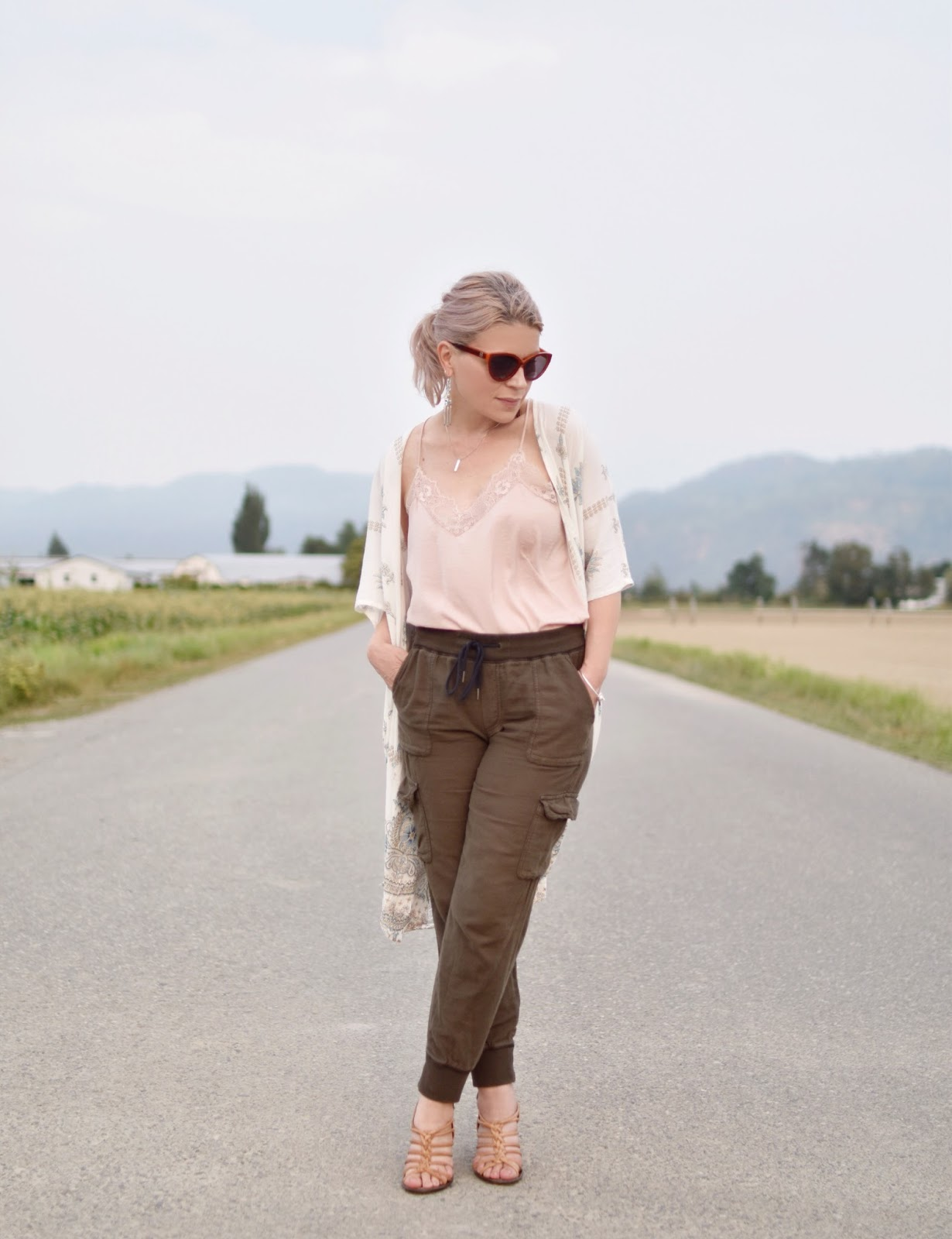 Monika Faulkner outfit inspiration - olive cargo pants, pink camisole, white damask-patterned kimono, strappy nude sandals
