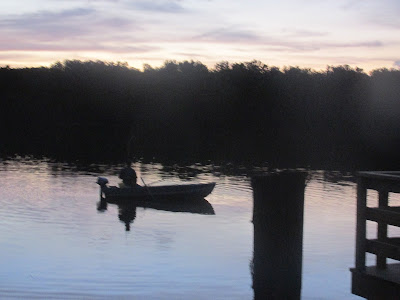 Lone fisherman at dusk-nice stroll by the lake.  Vickie's Kitchen and Garden