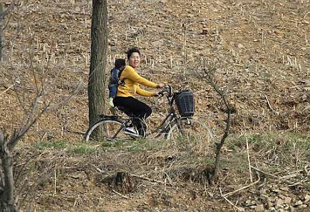 Korean woman rides a bicycle