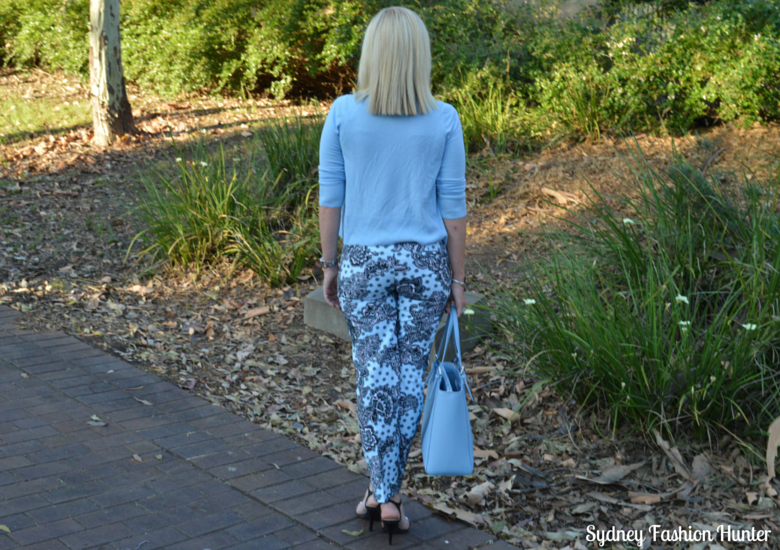 Blue Printed Pants, Black Sleeveless Shirt, Light Blue Cardigan. Light Blue Tote, Black Sandals