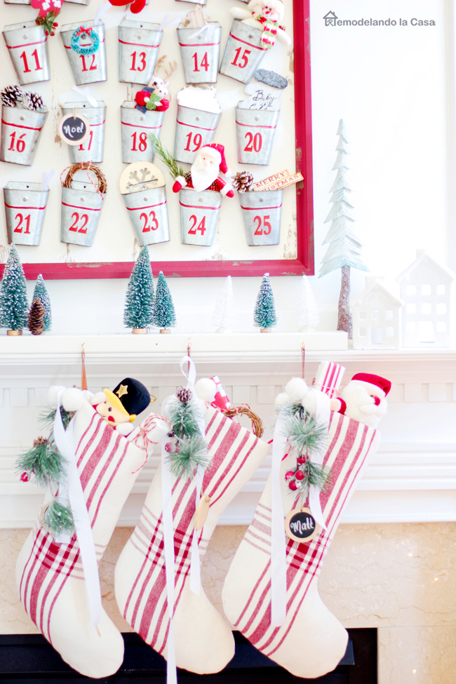 Hanging on the mantel Christmas stockings with advent calendar