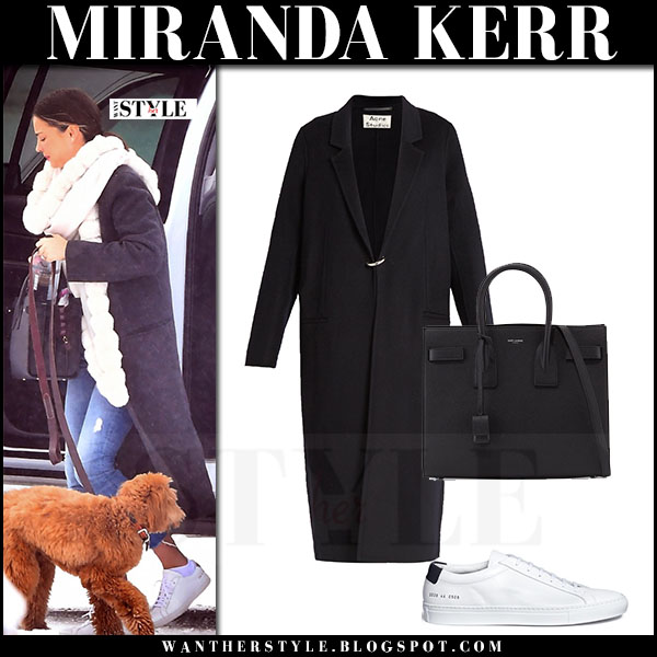 Miranda Kerr in black coat acne foin, skinny jeans and white sneakers common projects achilles what she wore