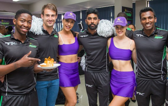 Hollywoodbets Dolphins Players with Cheerleaders - Sibonelo Makhanya, Daryn Dupavillon, Cody Chetty, Senuran Muthusamy - Cricket - Sponsorship - Bunny Chow