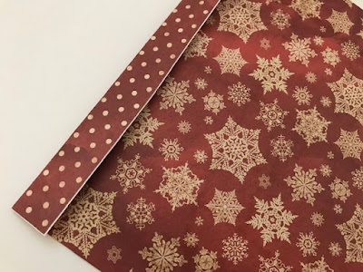 Gluing Christmas paper together to make a gift bag