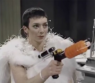 Servalan in white feathers