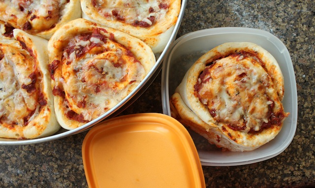 Food Lust People Love: Imagine a soft dough, shaped like cinnamon rolls, but savory, baked up with pizza sauce and mozzarella. Madam Wong's Pizza rolls are delicious and portable. Perfect in a lunchbox!