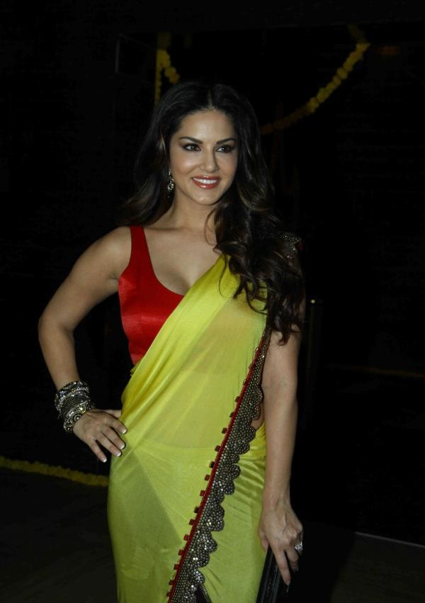 Sunny Leone Hot Stills In yellow Saree