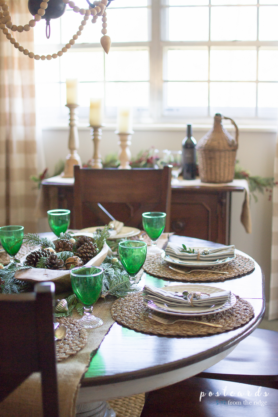 natural farmhouse table with vintage green glasses