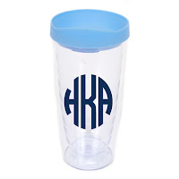 White Background of Clear Tumbler with Blue Lid