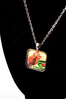 https://www.etsy.com/listing/601437055/handmade-glass-tile-art-pendant-necklace?ref=related-2