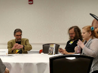 A few members of the anthology panel waiting for attendees to arrive.