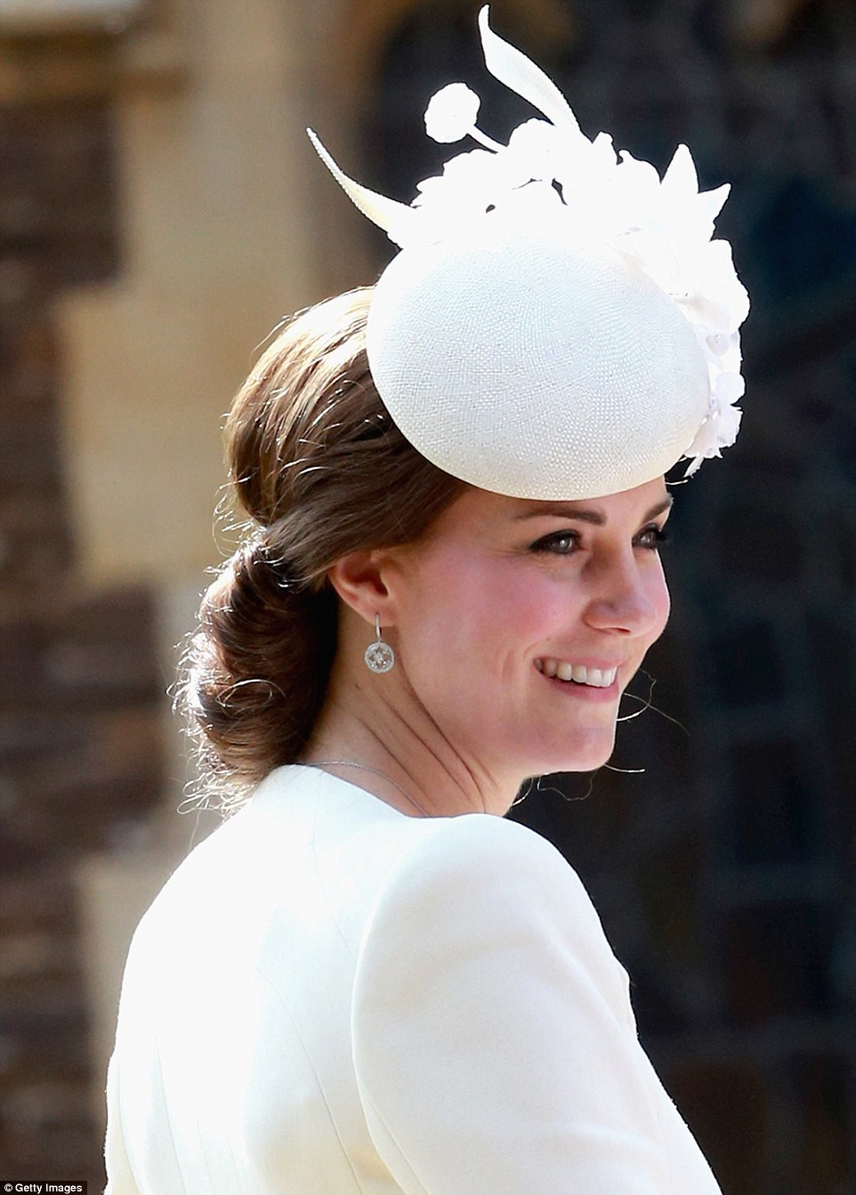 Kate Middleton wears Alexander McQueen with a Jane Taylor hat at daughter's christening
