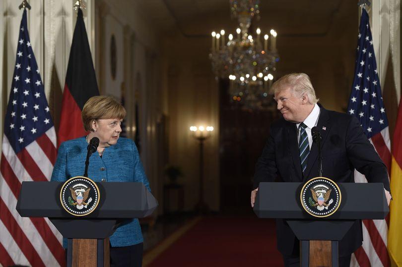 TOPSHOT-US-President-Donald-Trump-and