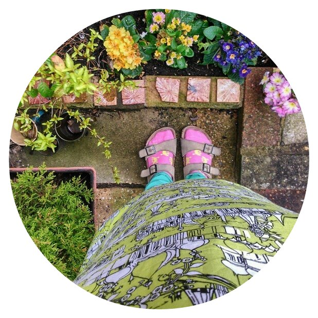 In my garden in socks and sandals
