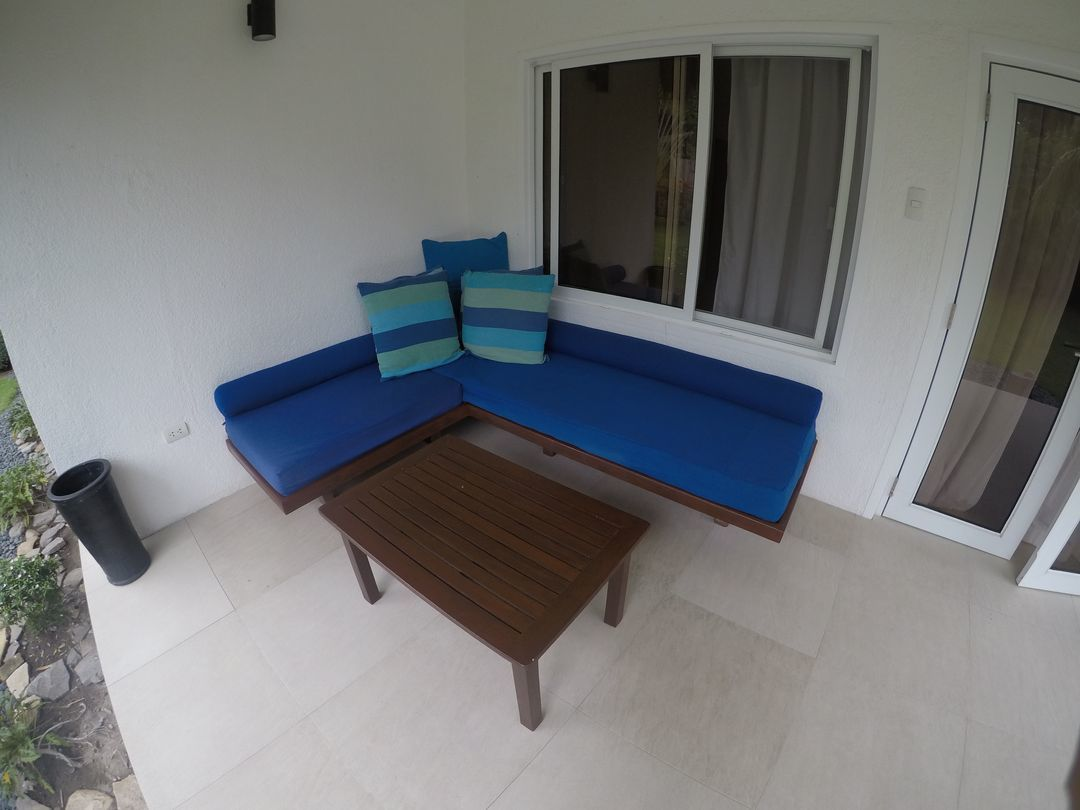Couch outside the room at Atmosphere Resorts & Spa
