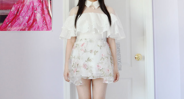 Details on the white sheer mesh paneled collared off-shoulder ruffled top from Twist X Turn, paired with a Liz Lisa-style flared floral skater skirt.
