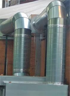 foto de tubos de salida de humos para chimeneas