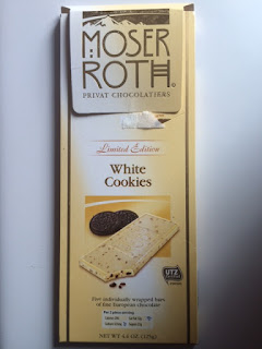 A packaged bar of Moser Roth Limited Edition White Cookies Chocolate Cookie Bar, from Aldi