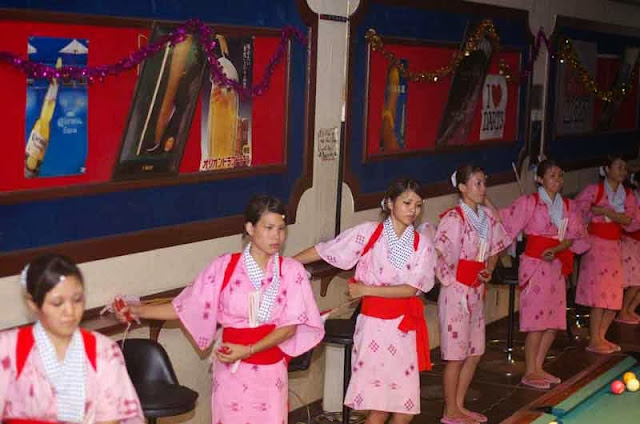 young ladies Eisa dance in night club, pink kimonos