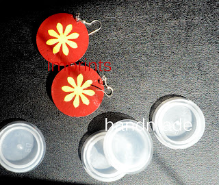 Plastic water can cap earrings