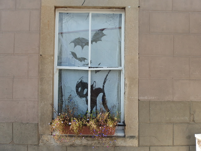 Window of the Old Road Tavern decorated for Hallowe'en
