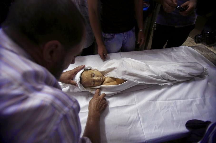 A Palestinian medic cleans the body of a 3-year-old girl for her funeral at a morgue in Gaza City, in the northern Gaza Strip, Wednesday, June 25, 2014. A rocket fired by Palestinian militants toward Israel exploded in the northern Gaza Strip early Wednesday, killing the girl and wounding three other people, a medical official said.