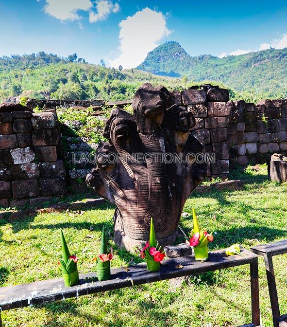 Centuries old Nak statue at Vat Pu