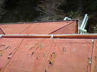 Red coated standing seam roof at end of coating effectiveness