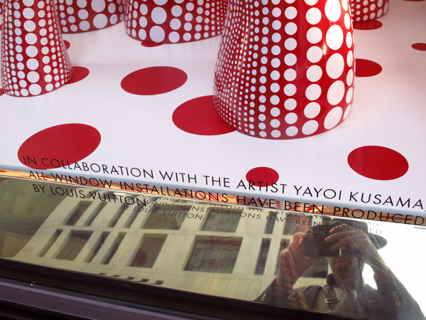 Yayoi Kusama - Louis Vuitton non-objective art installation and window display Sydney. Detail with artists credit in window.