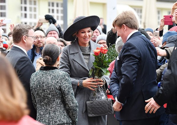 Queen Maxima wore  Natan coat and dress, Christian Louboutin grey suede toe pumps, Chanel Grey caviar leather coco bags