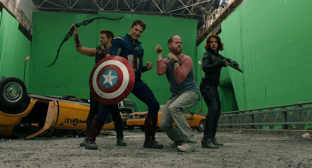 Jeremy Renner, Chris Evans, Joss Whedom, and Scarlett Johansson on the set of The Avengers (2011)