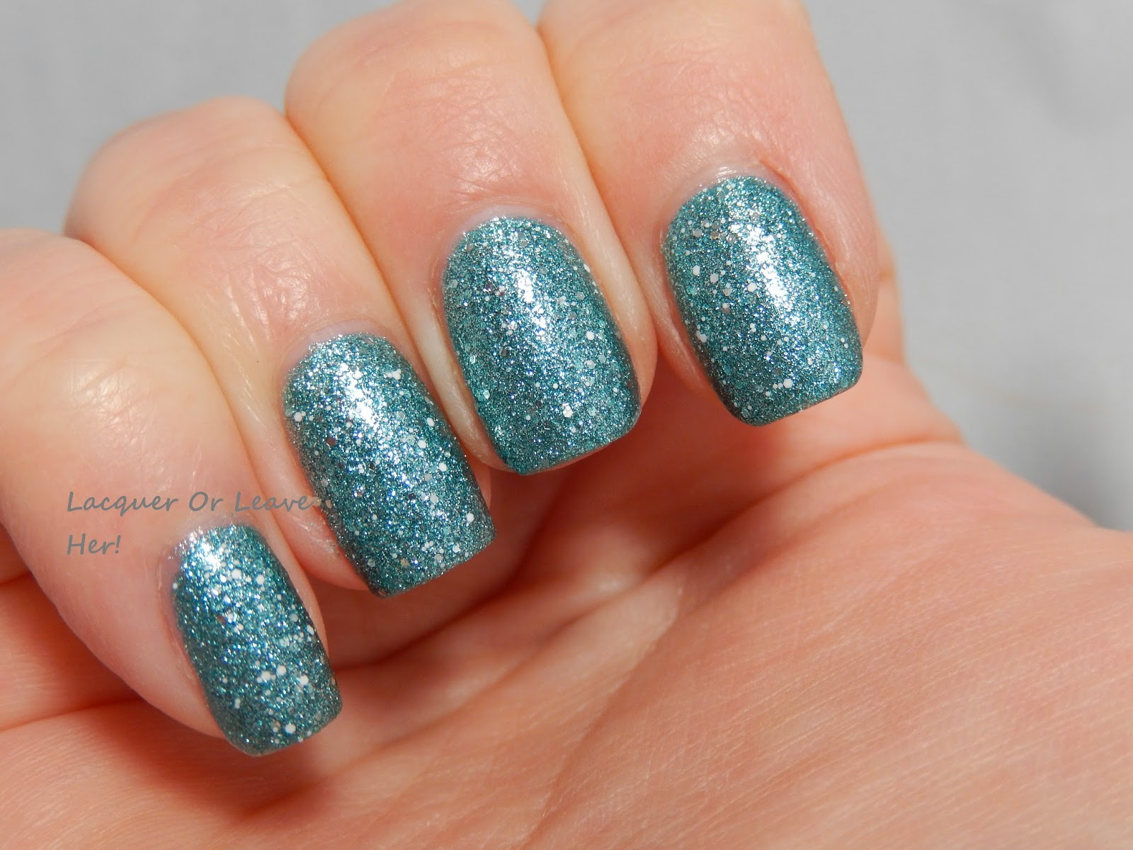 InDecisive Nail Lacquer White Speckled over Orly Aqua Pixel