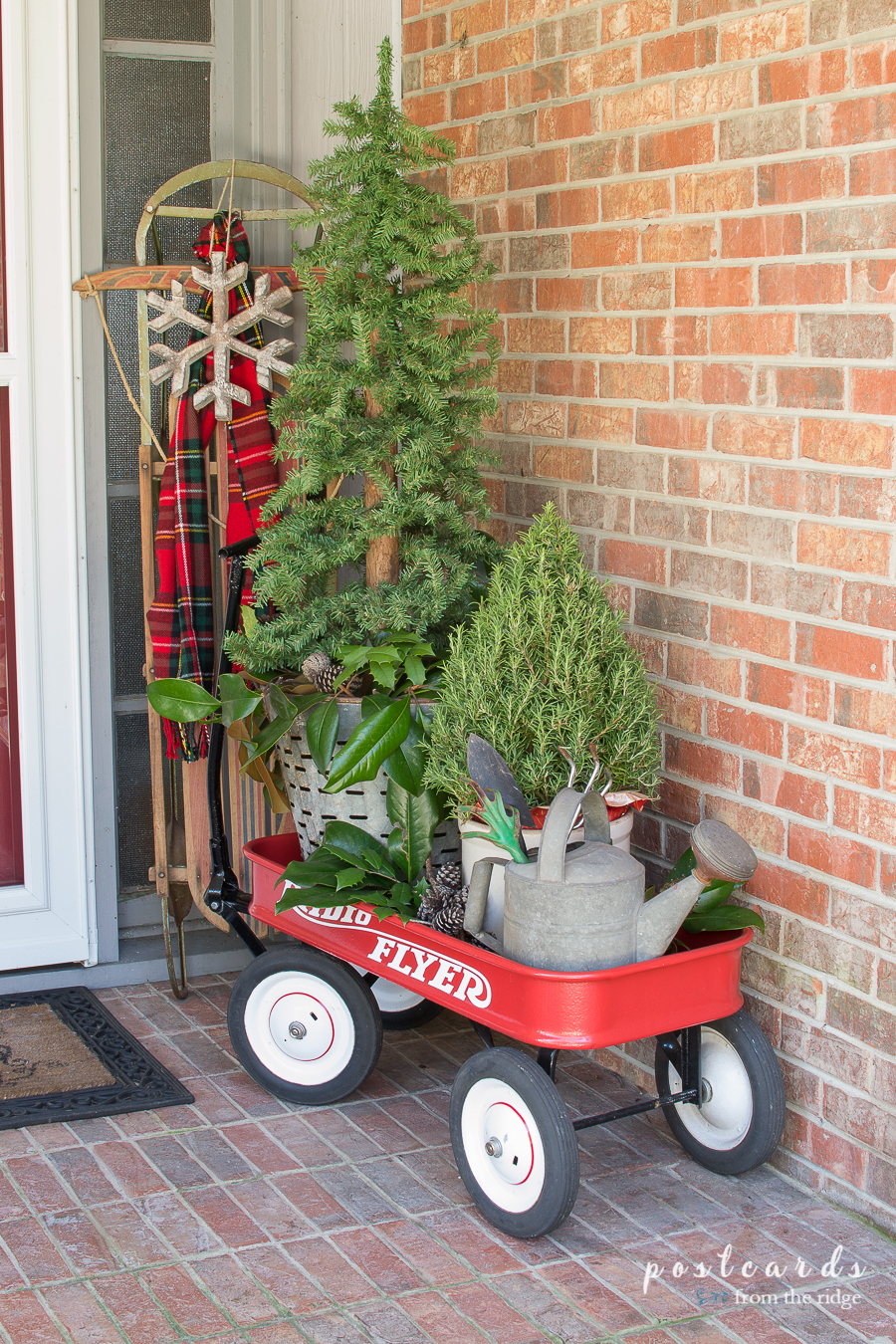 red wagon with old sled and Christmas decor
