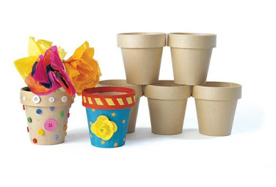 Decorate Paper Mache flower pots and fill with candy or travel sized items for an easy Girl Scout Founder's Day Craft