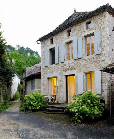 Breathtaking front facade of #Frenchfarmhouse with #blueshutters and limestone on Hello Lovely Studio