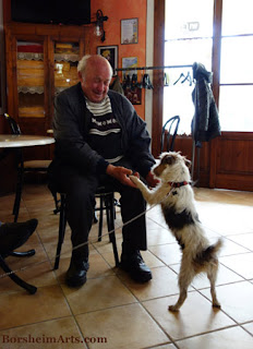 Dog dances with local man at restaurant for lunch