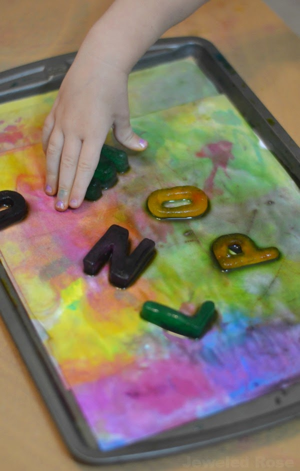 Painting with alphabet ice paints- these are easy to make and smell amazing!