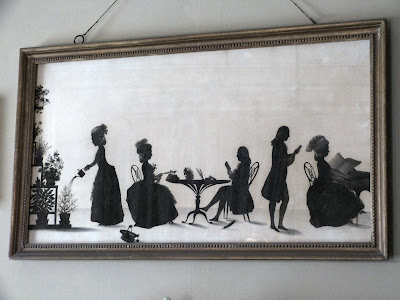 A silhouette ink drawing of the Parminter family in 1783 by François Torond above the mantelpiece in the Drawing Room, A la Ronde